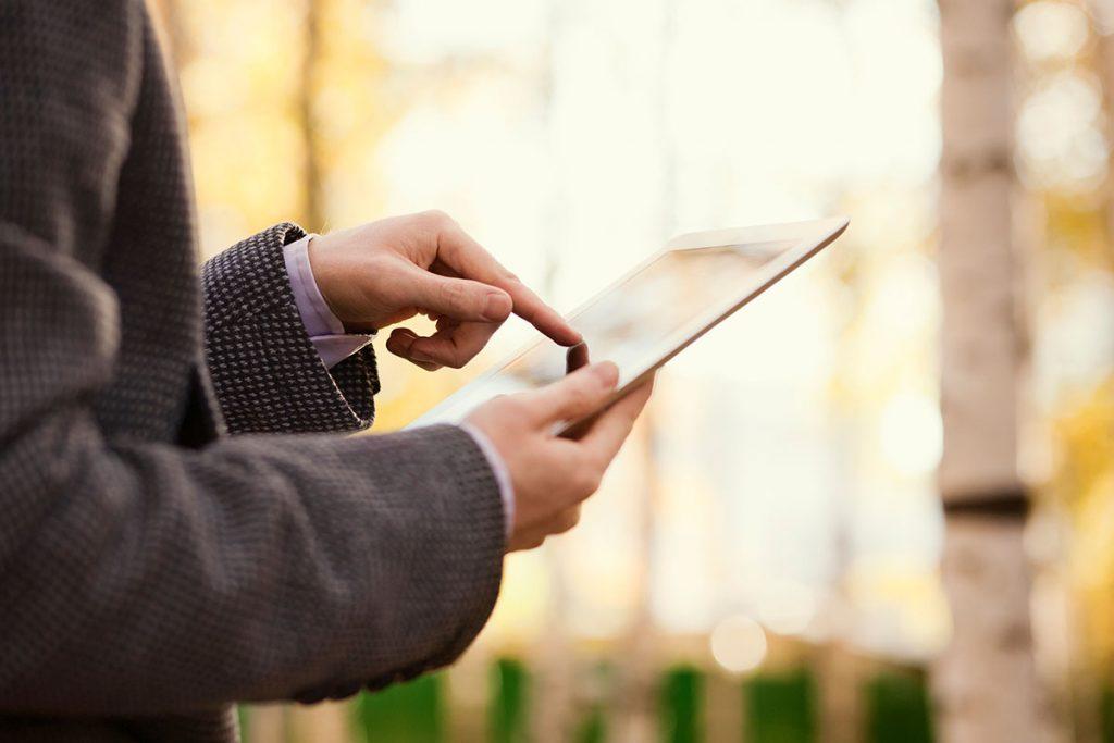 Man touching tablet