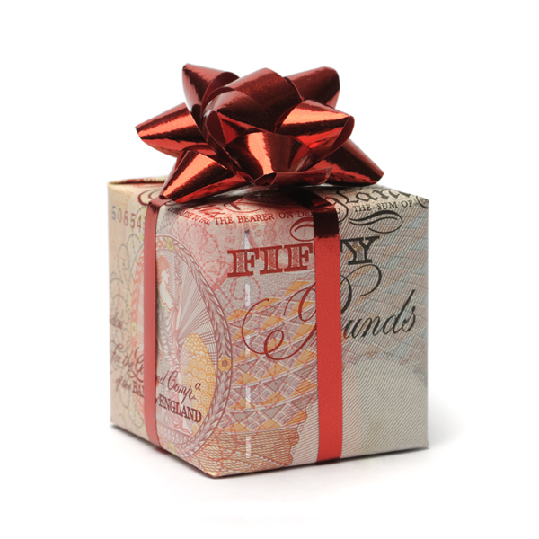 Gift box wrapped in an English pound with a red bow