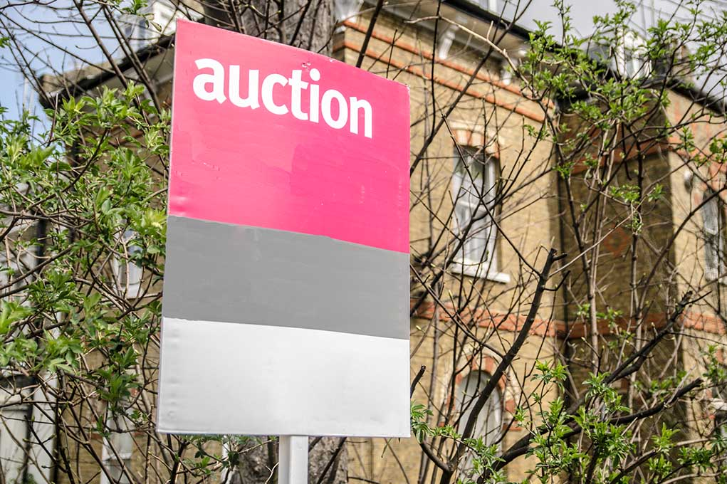 Auction sign on house