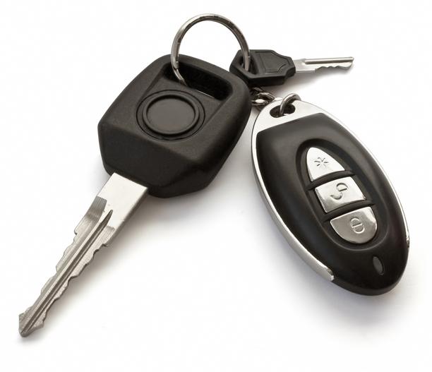 A set of car keys on a white background