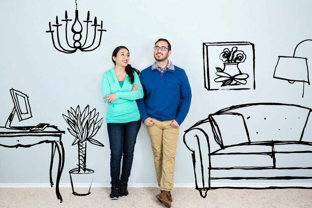 Couple with painted home background