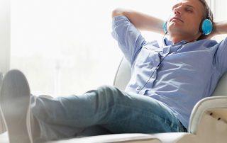 Man relaxing headphones
